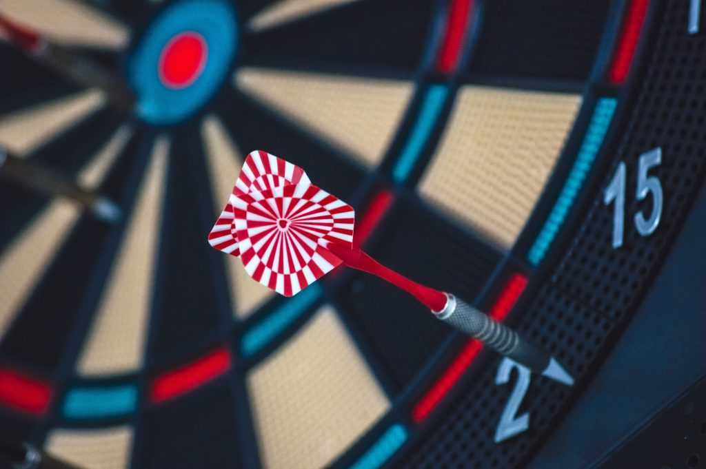 A dart hitting a dartboard way off the bull's eye - analogy for completing tasks even though they're not 'perfect'