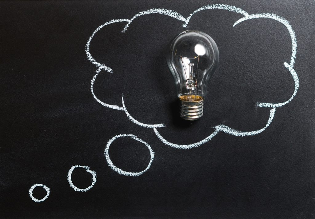 Picture of a lightbulb against a blackboard, signifying an 'idea'