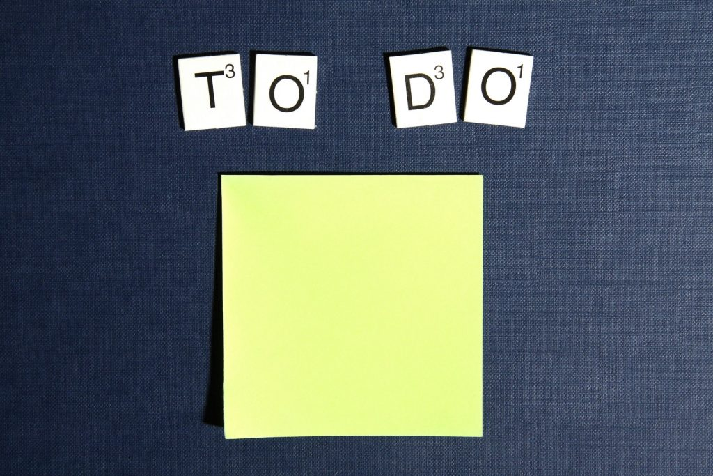 a picture of a to do list, with letters from scrabble and a post-it note, highlighting the value of a to do list in business