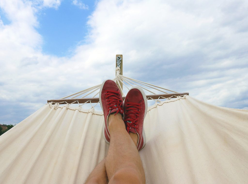 picture of a pait of fett on a hammock looking out on to the sky - talking about making time for yourself as an entrepreneur and taking pressure off