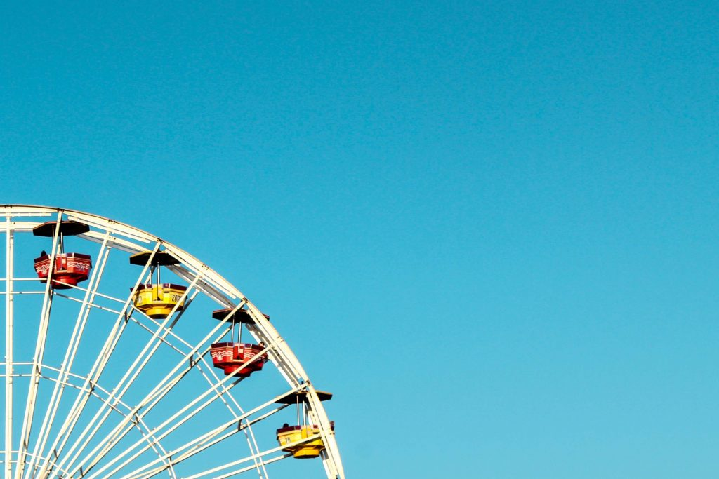 picture of half a ferris wheel turning in the sky - when you feel good and when you feel bad