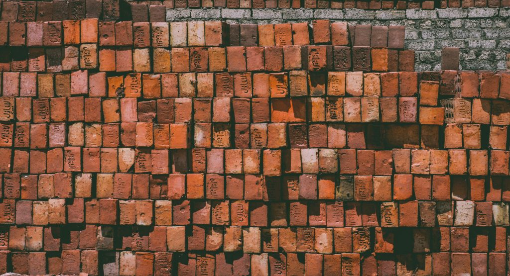 picture of bricks - placed on top of each other. representing different levels and building blocks in business