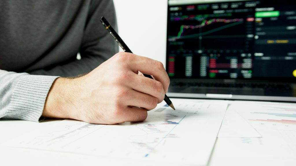 image of an entrepreneur sitting at a desk calculating numbers - representing business