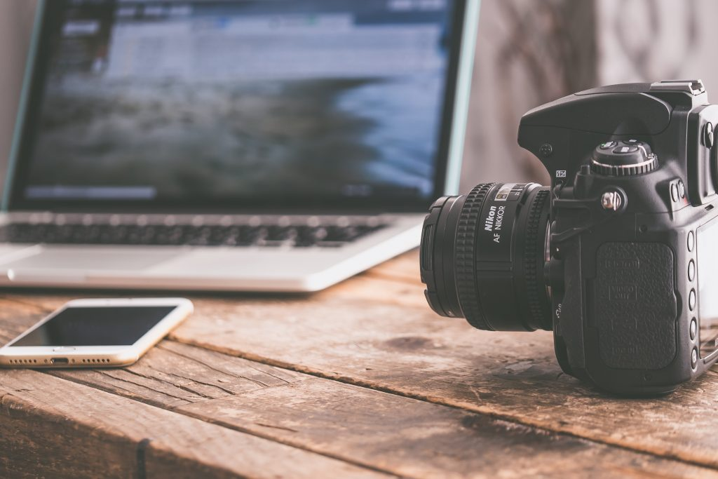 picture of a laptop and an SLR camera, talking about content creation