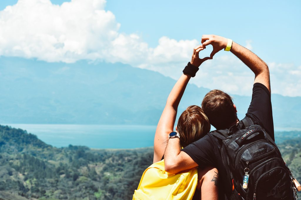 picture of couple hiking - representing influencers travelling, making money from content