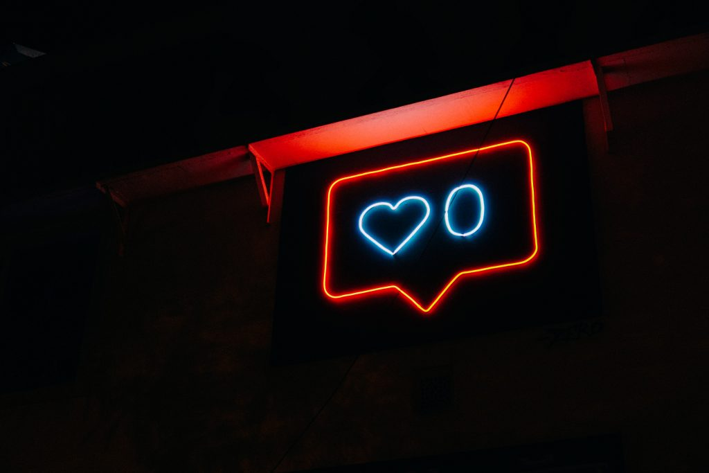neon sign of Instagram symbol for likes- in discussing followers making money for influencers