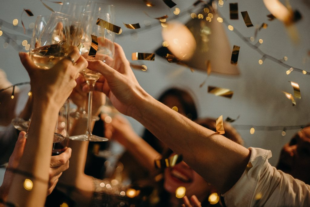 people clinking champagne glasses when opening a business comes to selling a business