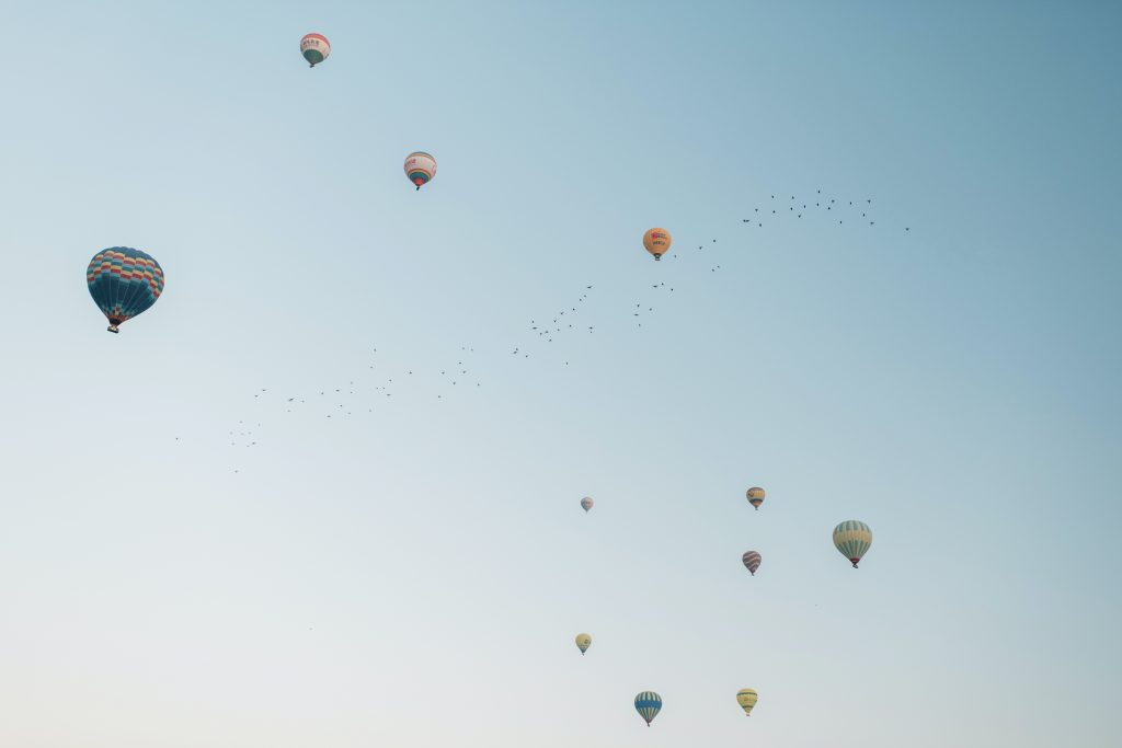 "image of air balloons in floating in the sky - representing ""showing off"" skills"