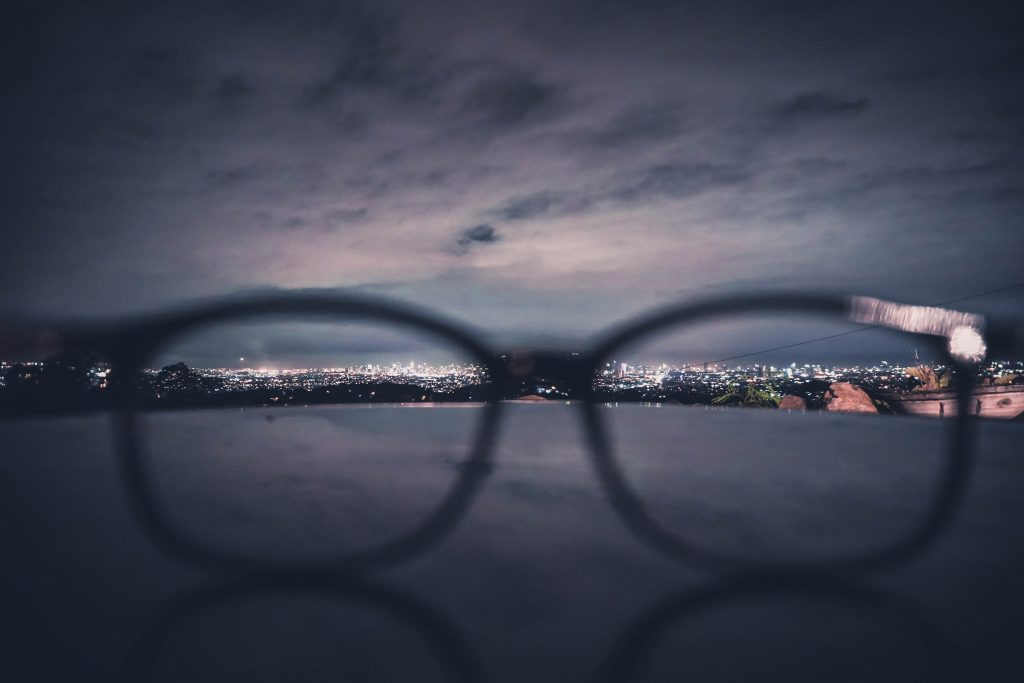 Hindsight is 20/20 when looking back in selling a business - image of glasses looking onto a horizon
