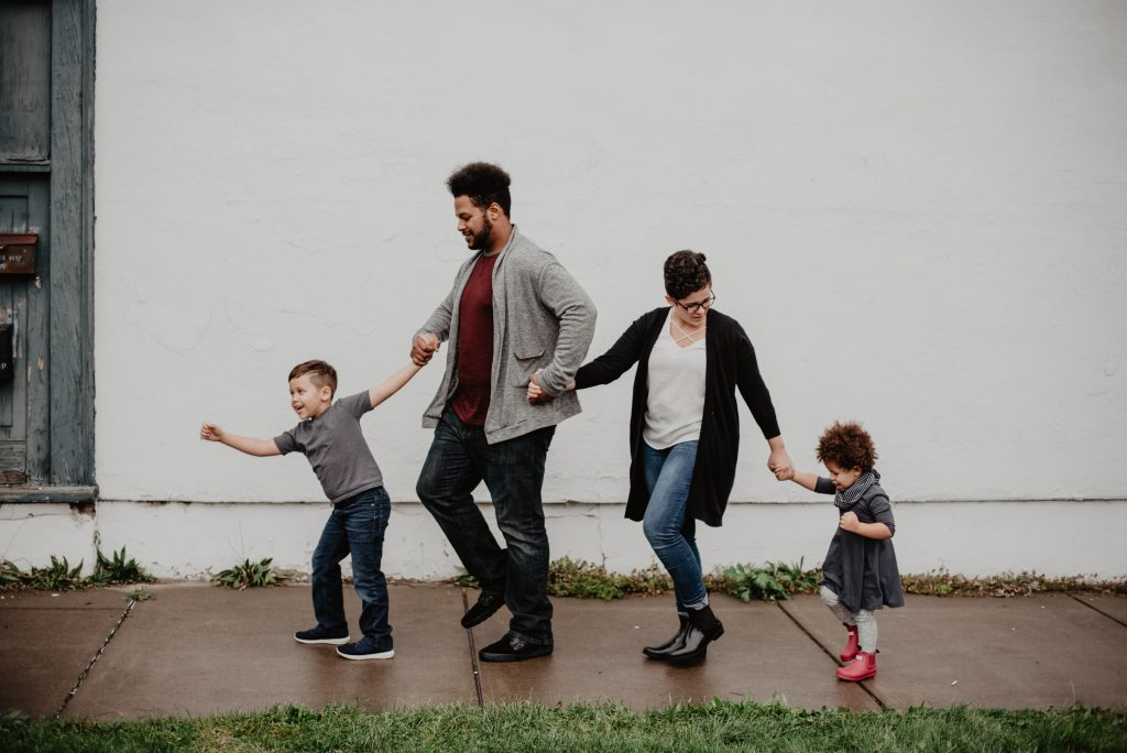 image of a family: mother, father and two children walking on footpath; your family can be one of the best people to ask