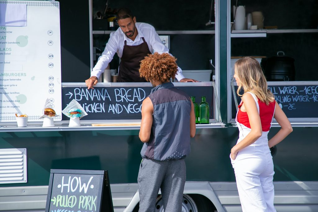 business innovation can mean new products or services to offer; image of man selling banana bread from his van
