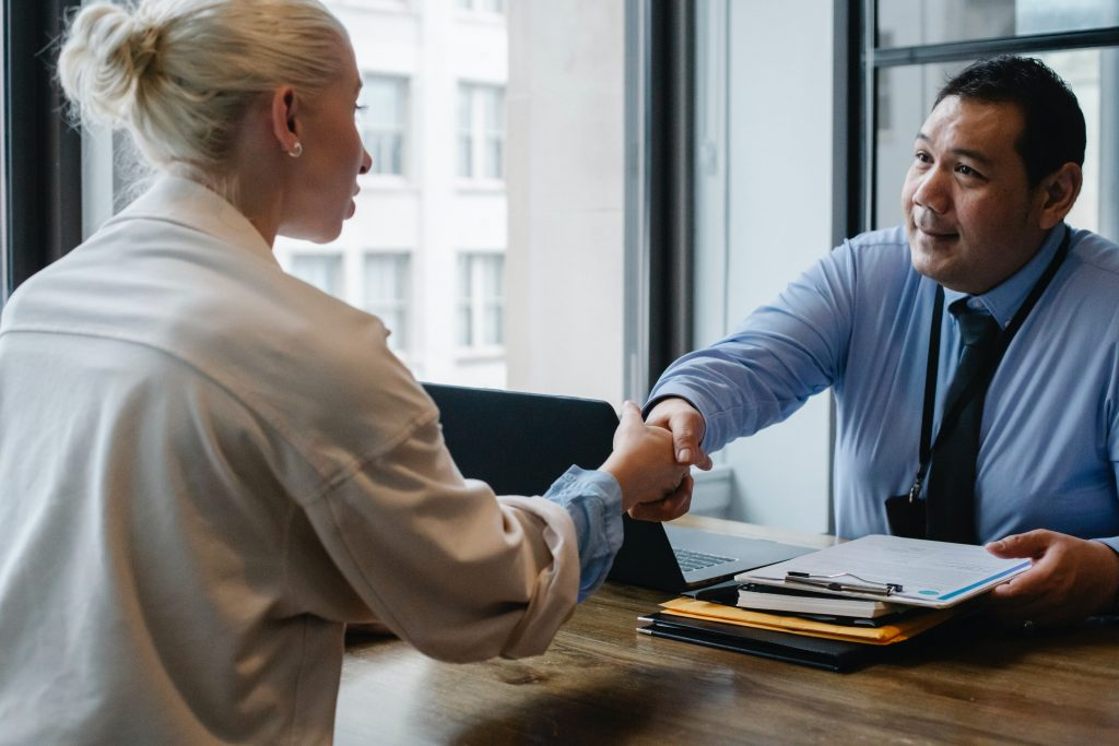 hand shaking in office setting